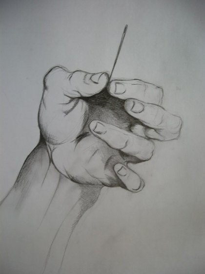Hand holding sewing needle